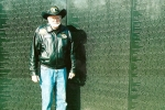 Bill Semar at the Vietnam Memorial laying roses to remember Sgt Ronald Dennis KIA 12/24/69